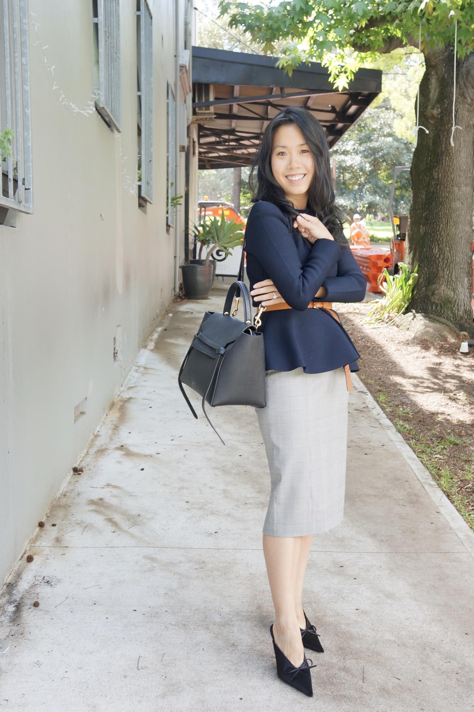 woman wearing belted jacket for work with celine belt bag