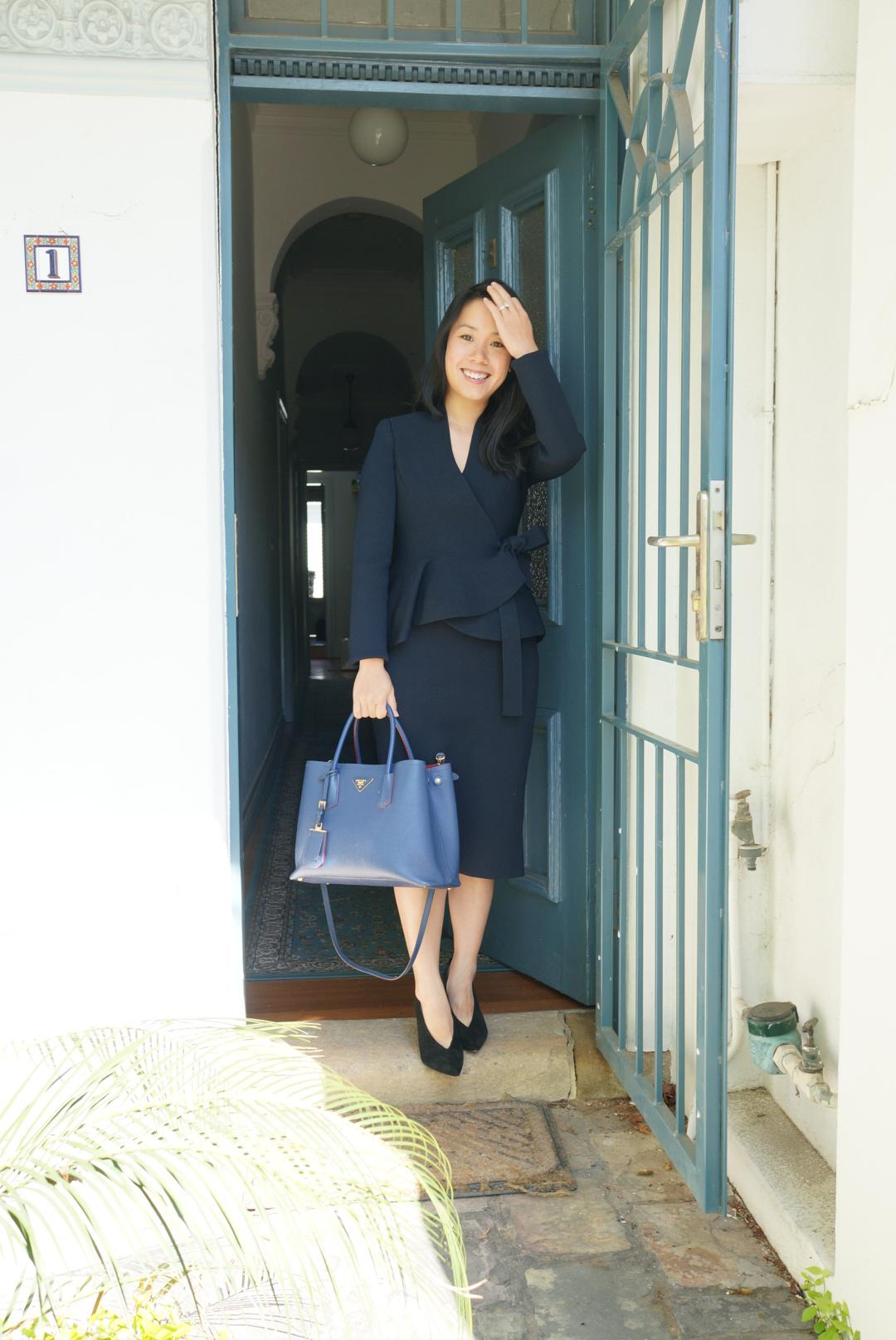 prada saffiano double tote styled in office look in blog post about selling designer bag tips