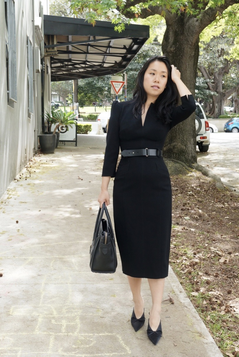 Woman wearing Karen Millen Forever Dress in Black