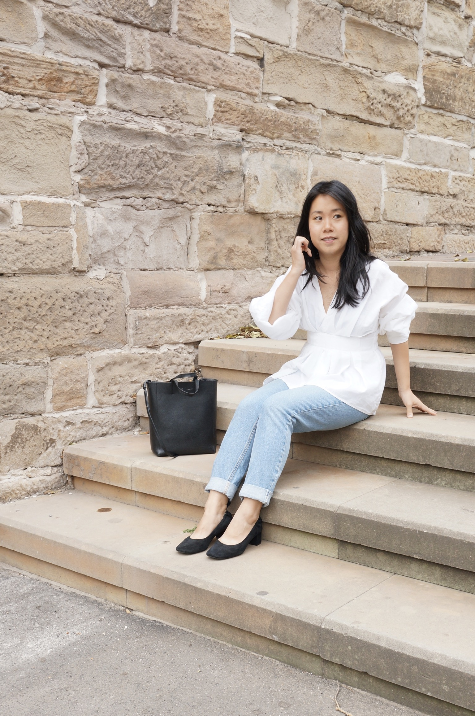 Woman wearing jeans, white shirt and Everlane Day Heels