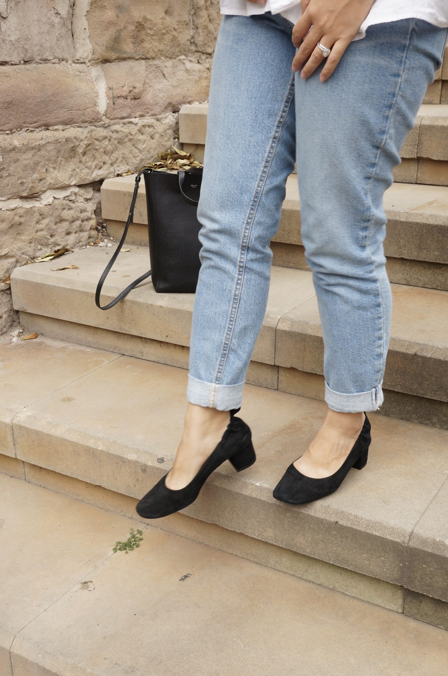 Woman wearing jeans and black Everlane Day Heels