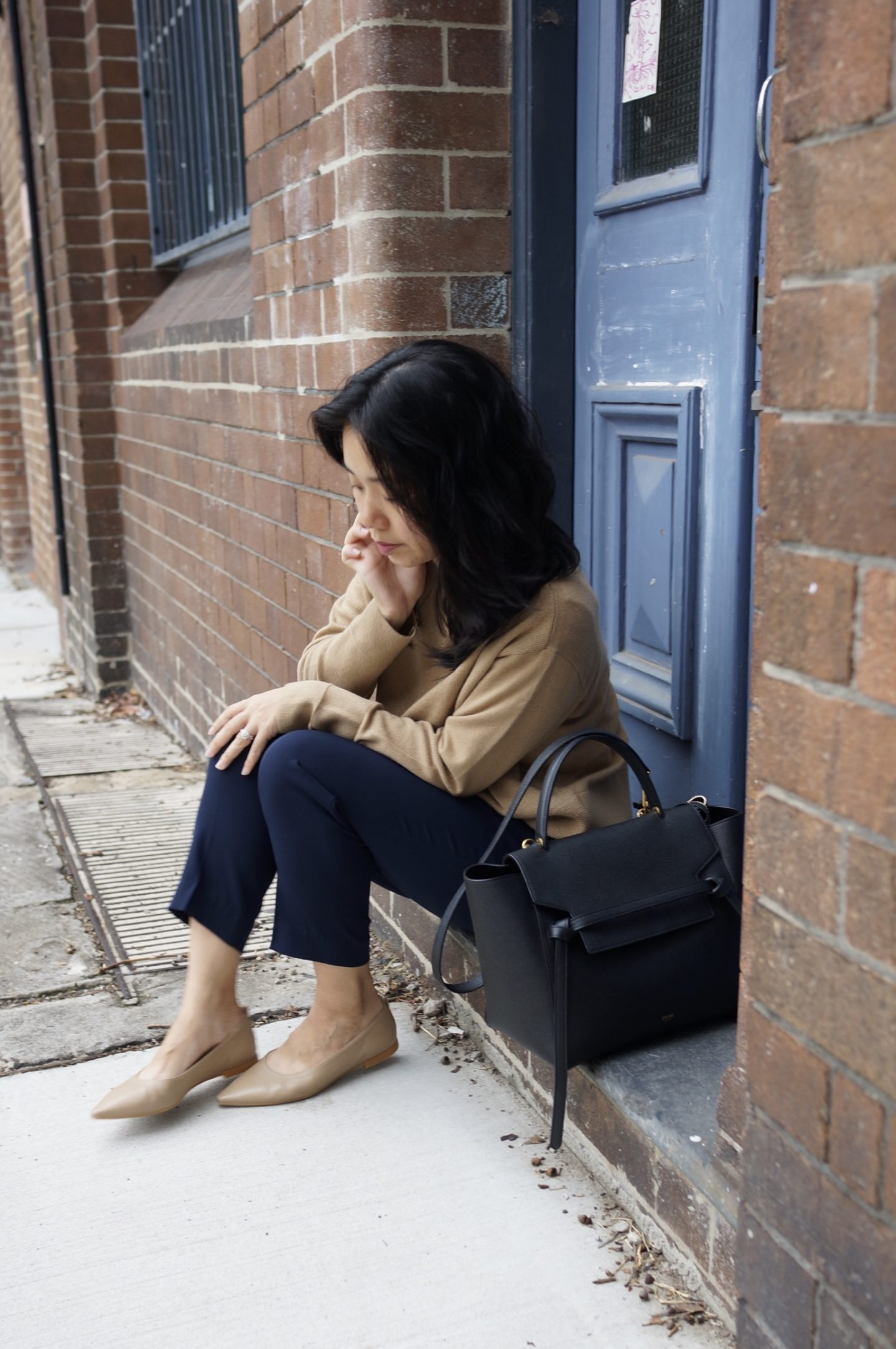 woman wearing everlane cashmere, celine belt bag and everlane 40 hour flat in taupe