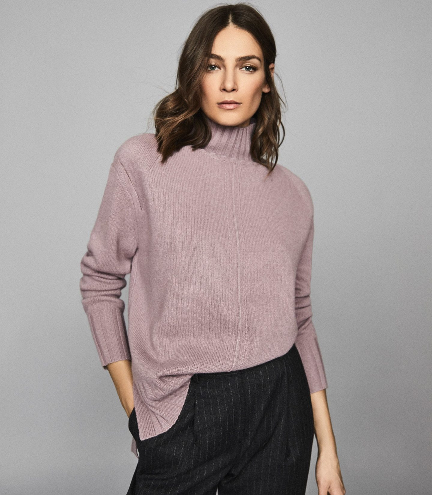 woman wearing mauve turtleneck from reiss knitwear collection
