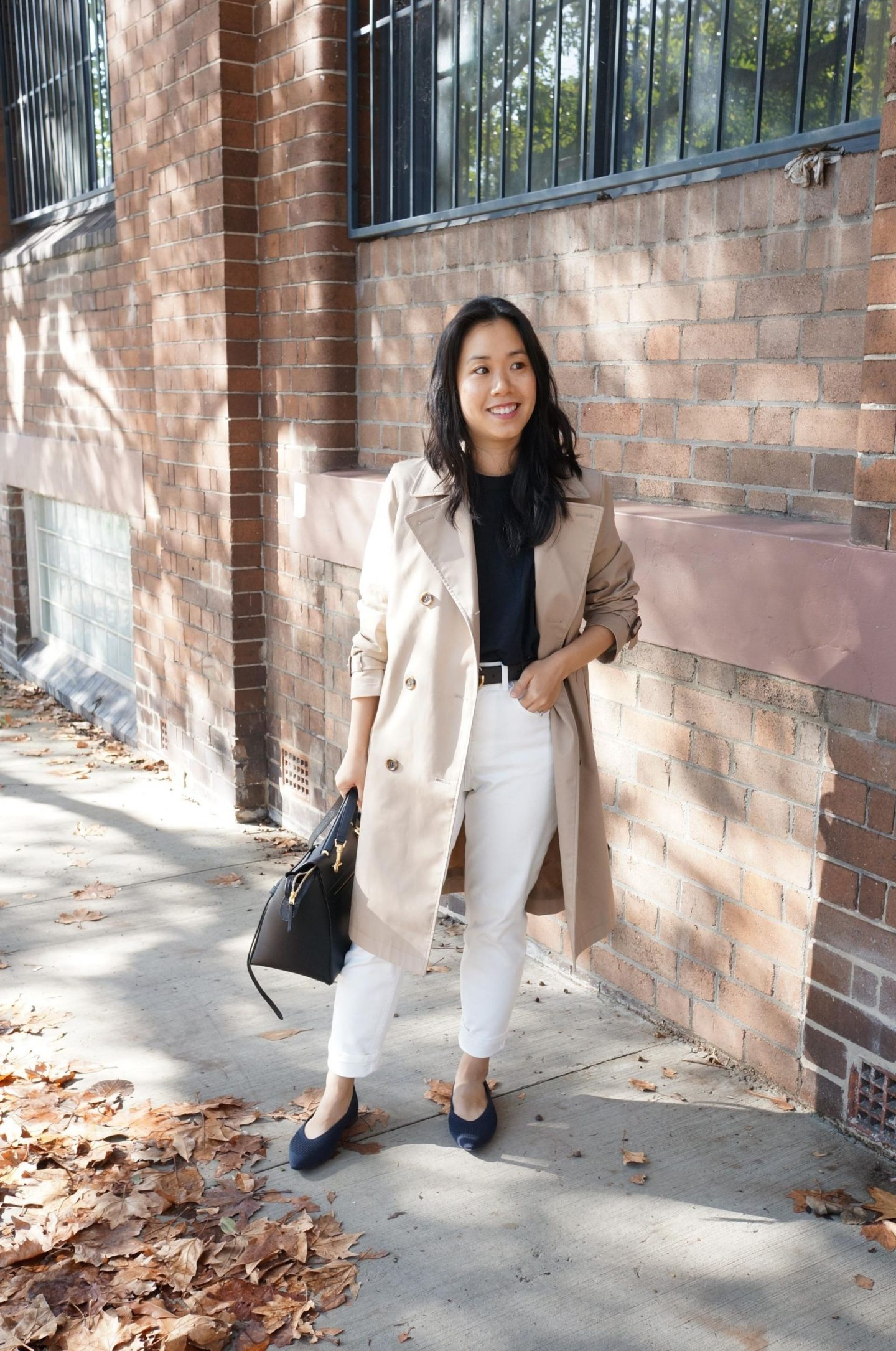 everlane curvy cheeky straight white jeans with uniqlo trench coat and celine belt bag