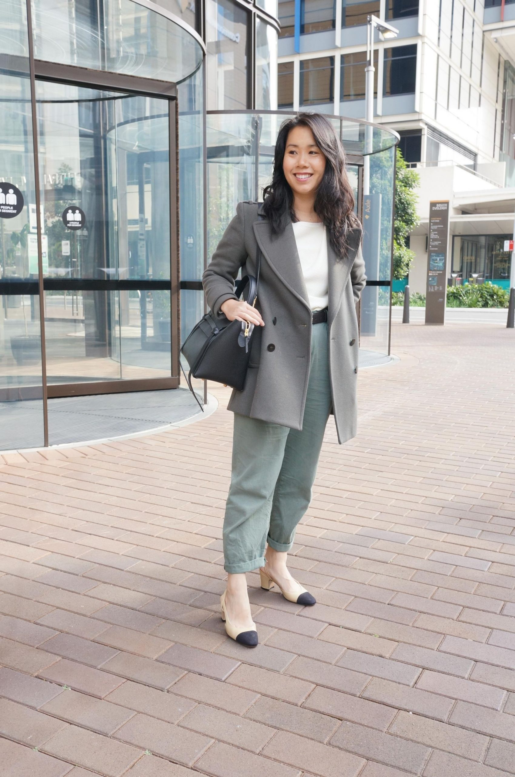 styling khaki pea coat and khaki pants, chanel slingbacks