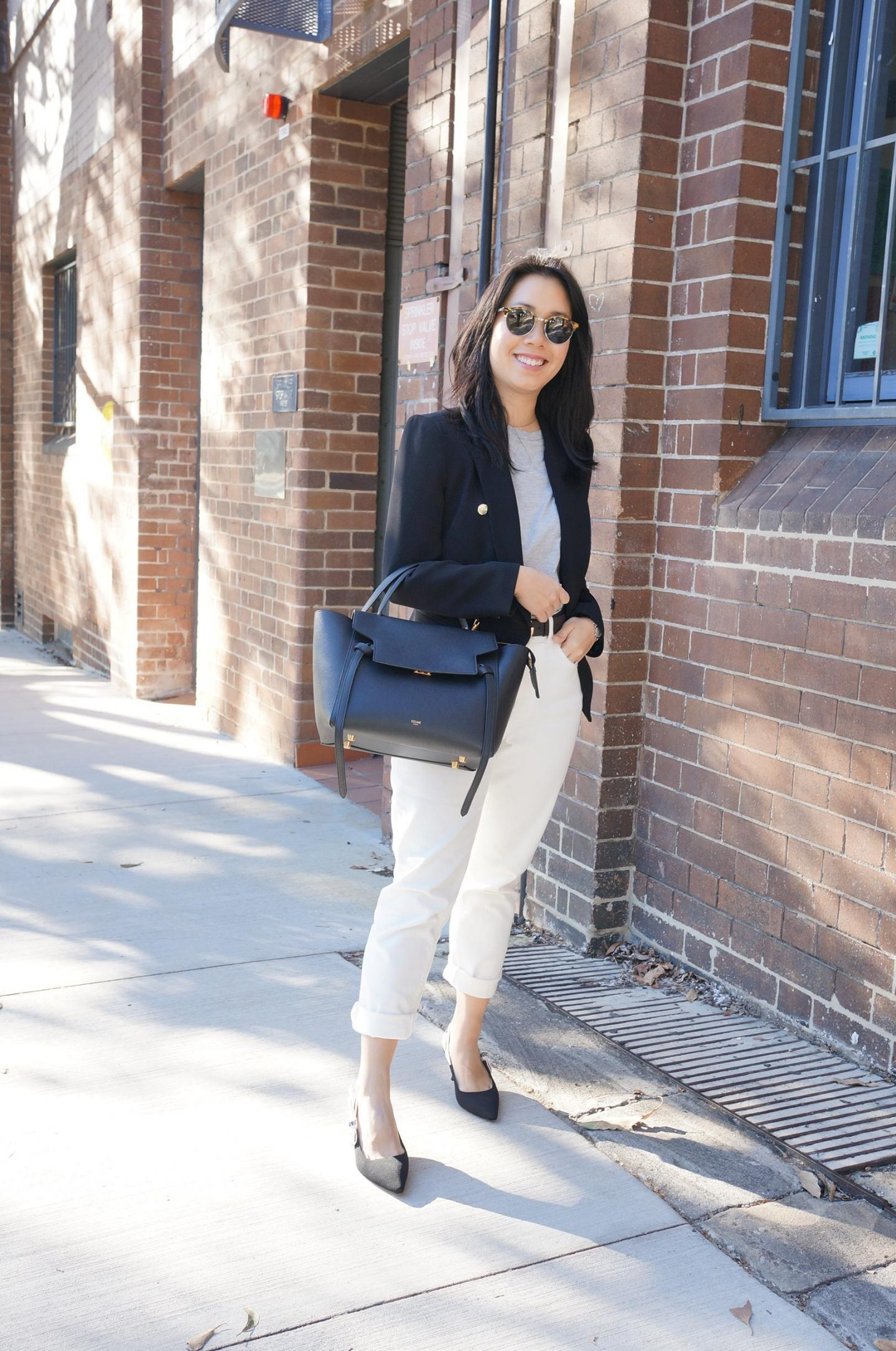 everlane curvy cheeky straight white jeans with sarah lloyd black blazer and celine belt bag
