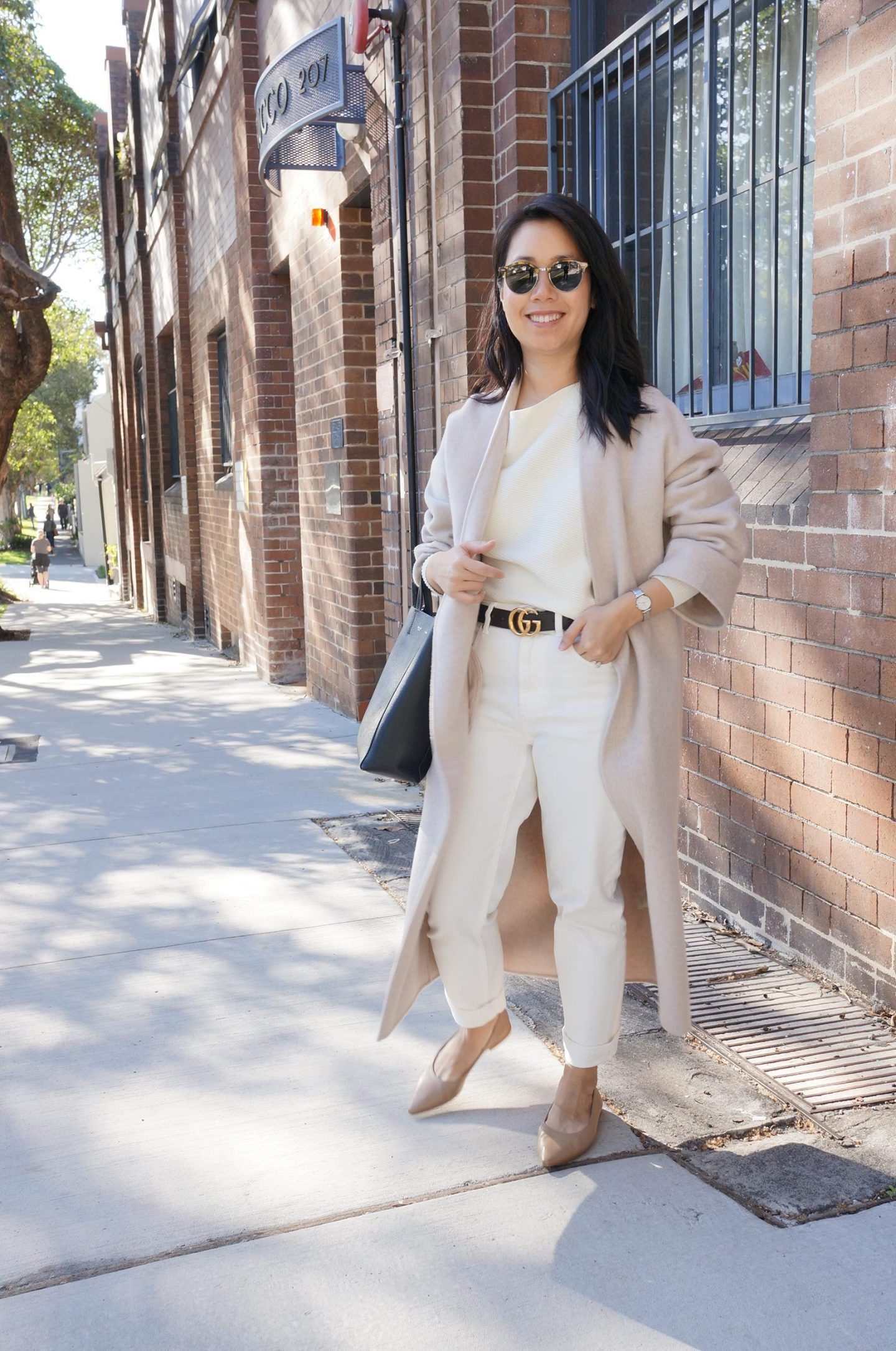 woman in light neutral outfit in blog post about shifting dress codes in the office