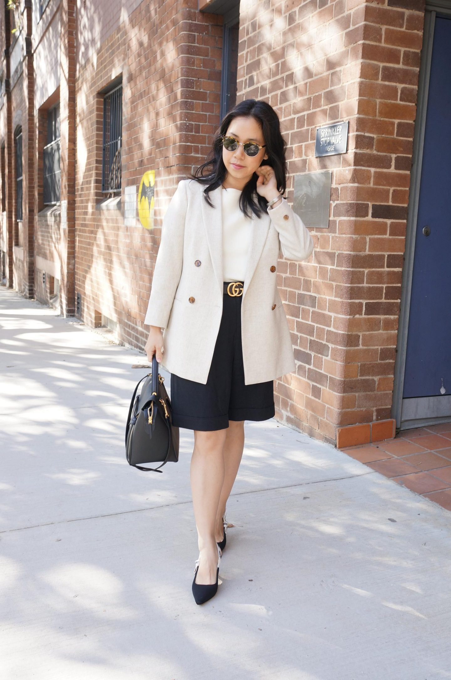 Work and office appropriate shorts, everlane put together pleat shorts, reiss blazer, gucci belt outfit with celine belt bag