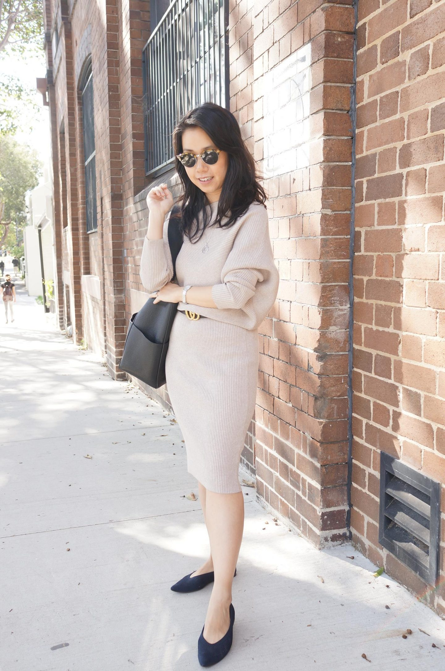 asian woman in reiss lara dress in blog post about shifting dress codes following covid lockdown restrictions lifting