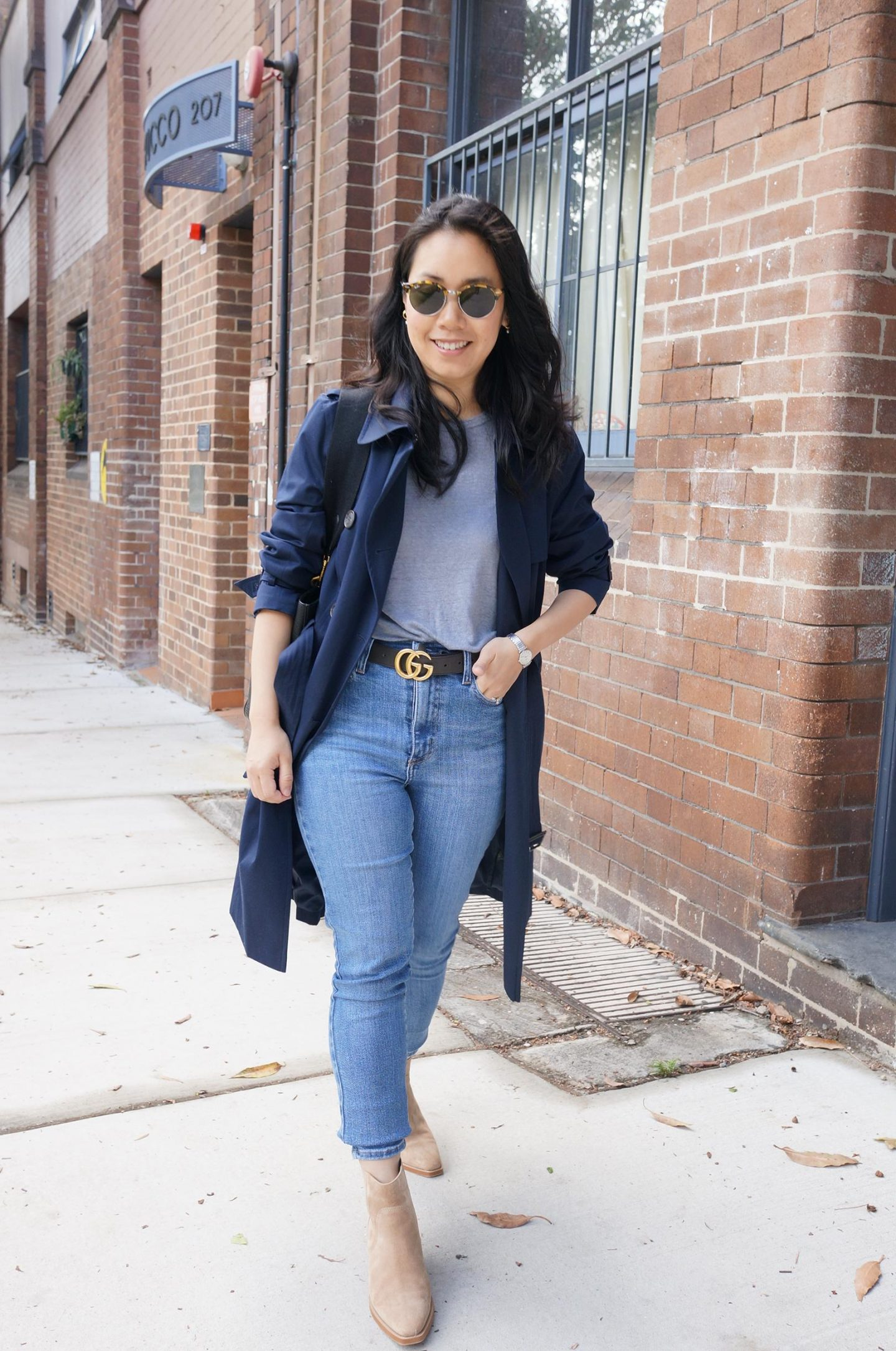 everlane western boots styled with marks & spencer trench coat and gucci belt