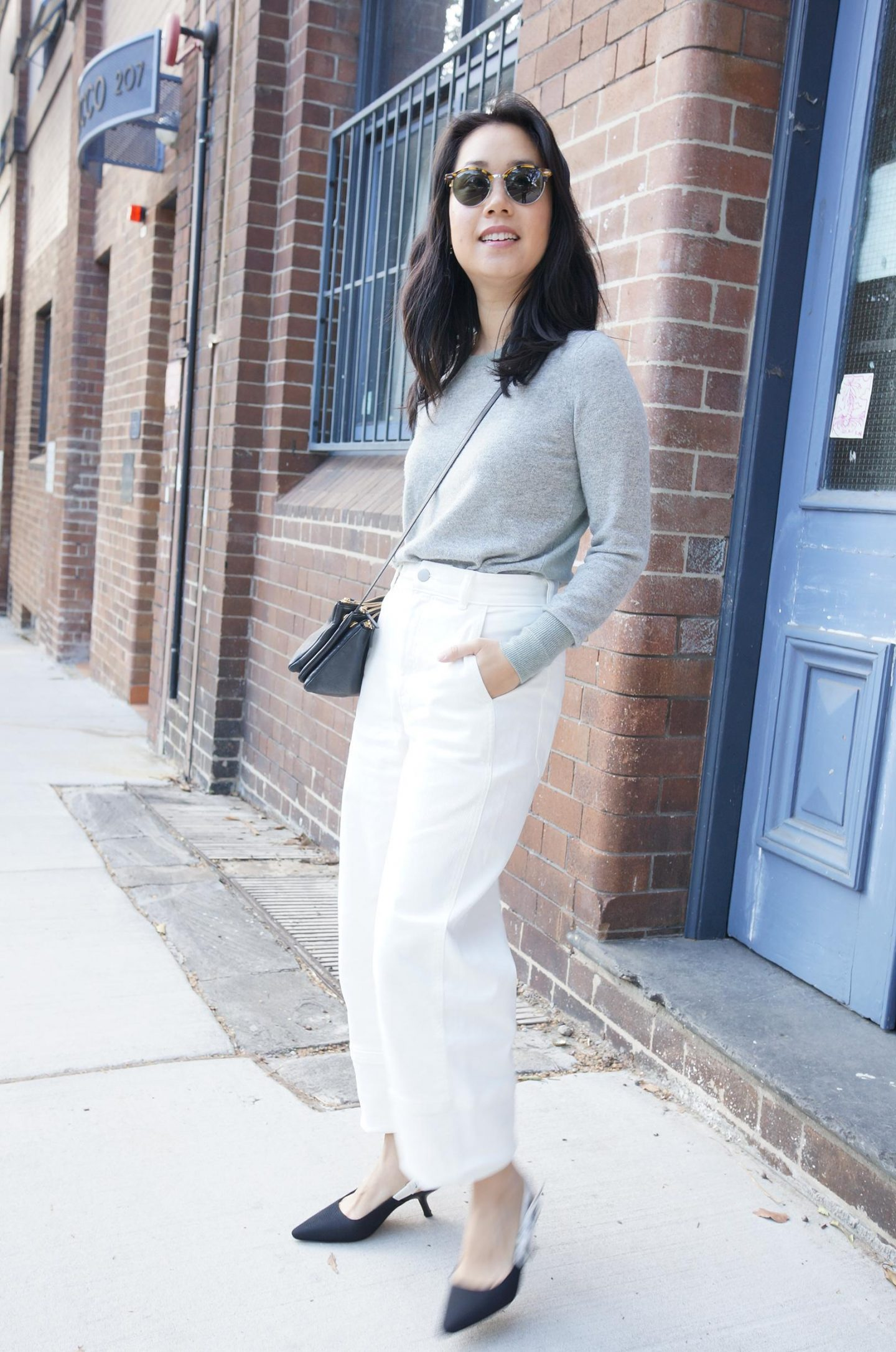 photo of asian woman wearing celine trio bag and white jeans in blog post about designer bag regrets