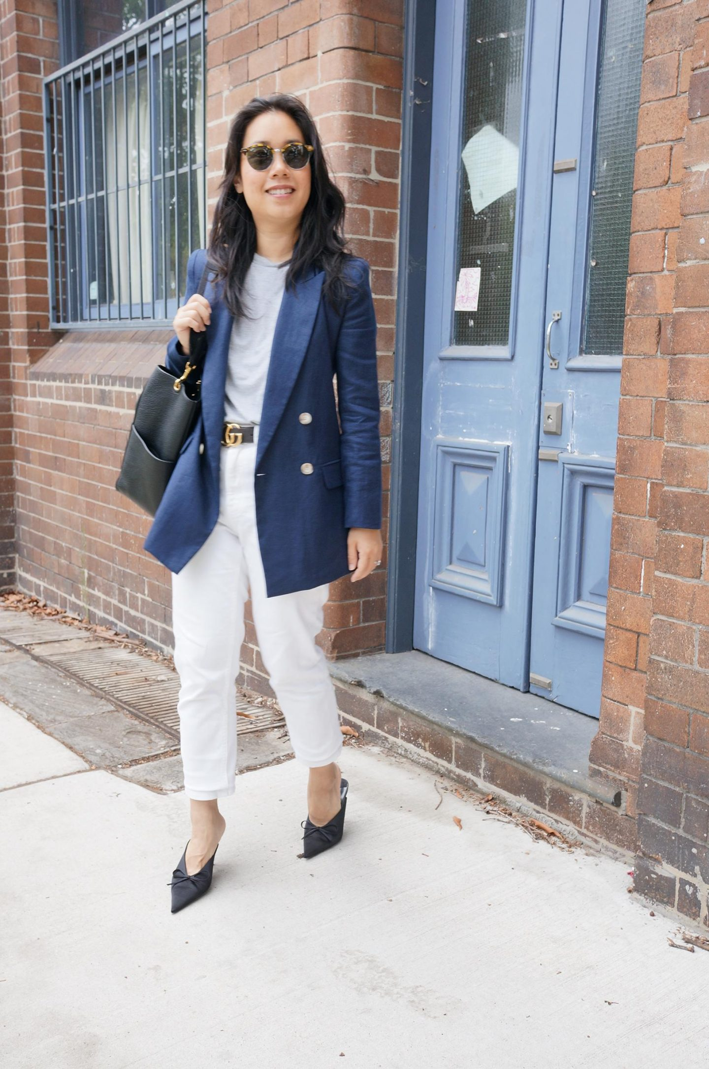 sarah lloyd duchess of cambridge navy blazer styled in smart casual outfit in blog post about first designer purchase tips