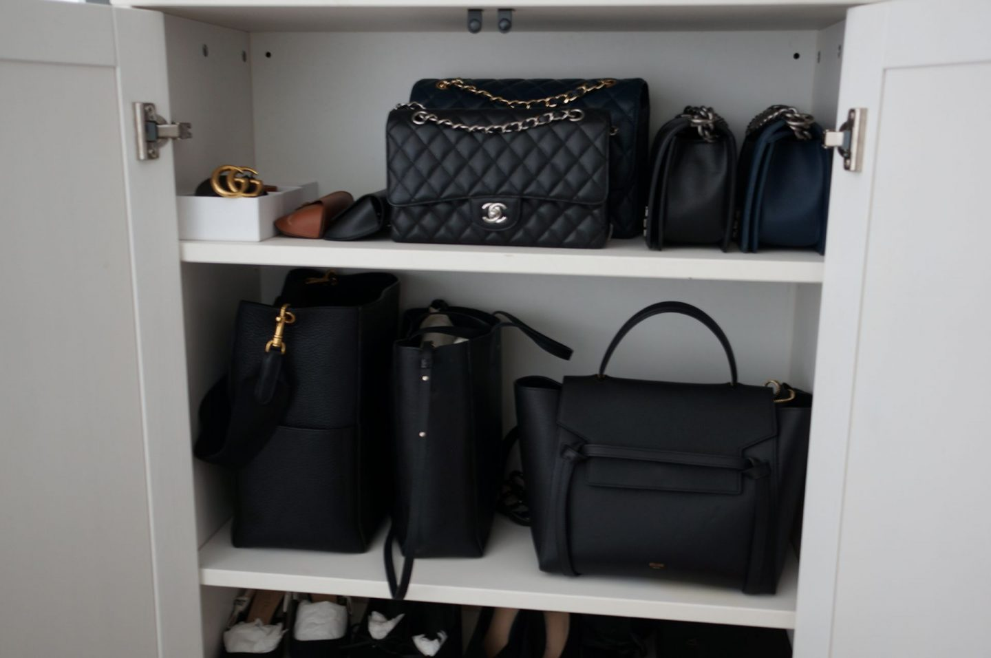 close up photo of inside wardrobe with designer handbags and accessories in blog post about caring for your handbags so they last