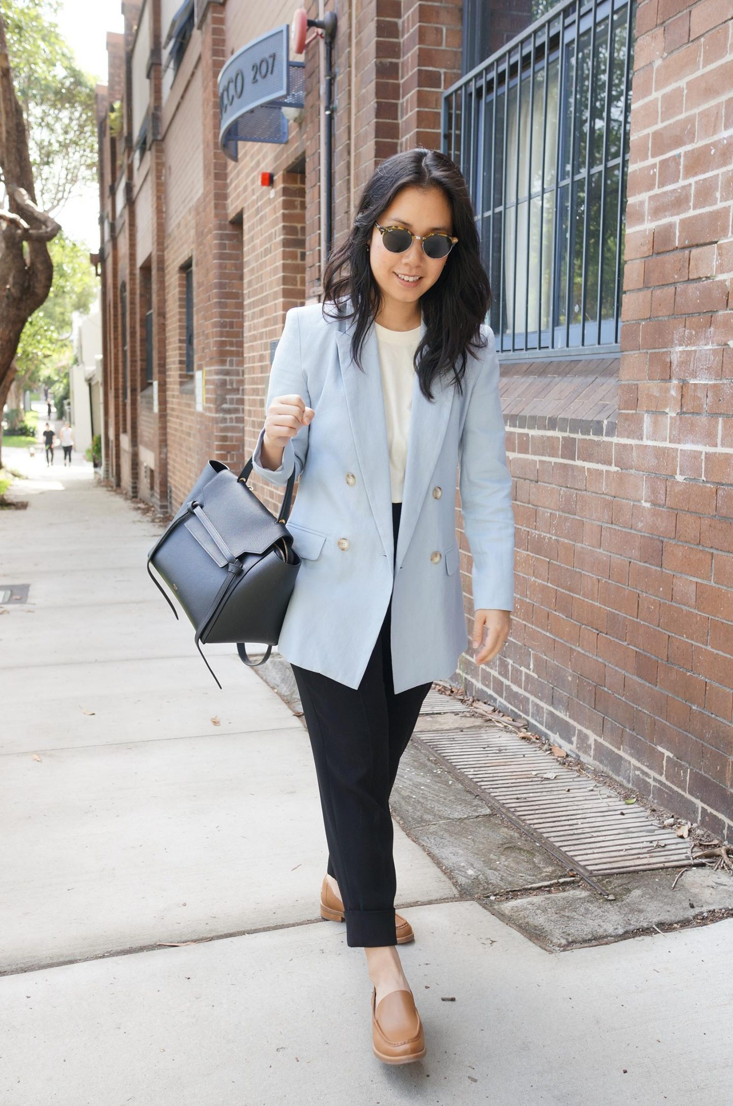 woman wearing smart casual outfit featuring sarah lloyd blazer and everlane modern loafer in camel in comprehensive review blog post