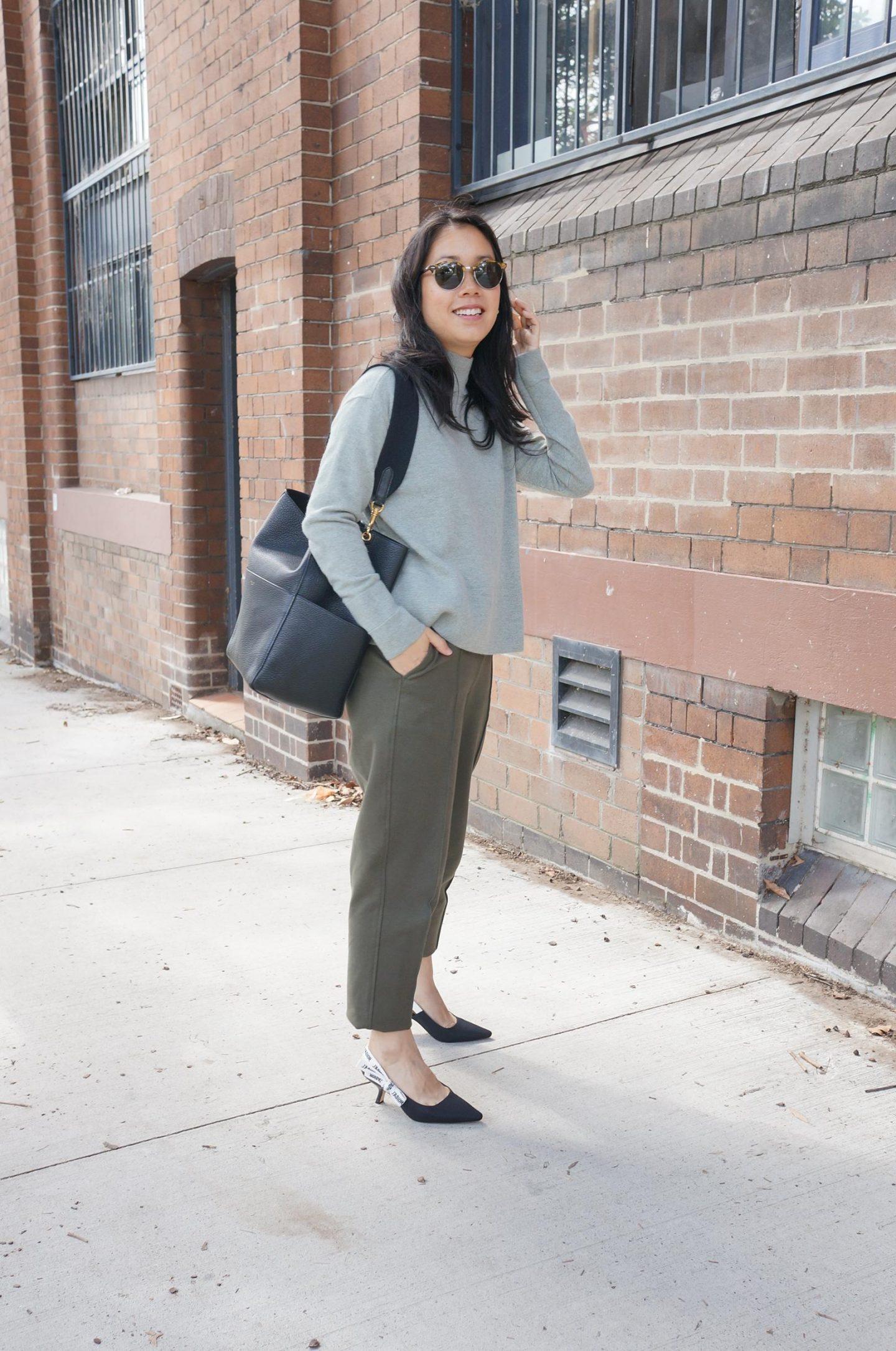 asian woman wearing everlane cashmere turtleneck styled with everlane dream pant, j'adior slingback pumps and celine sangle bag