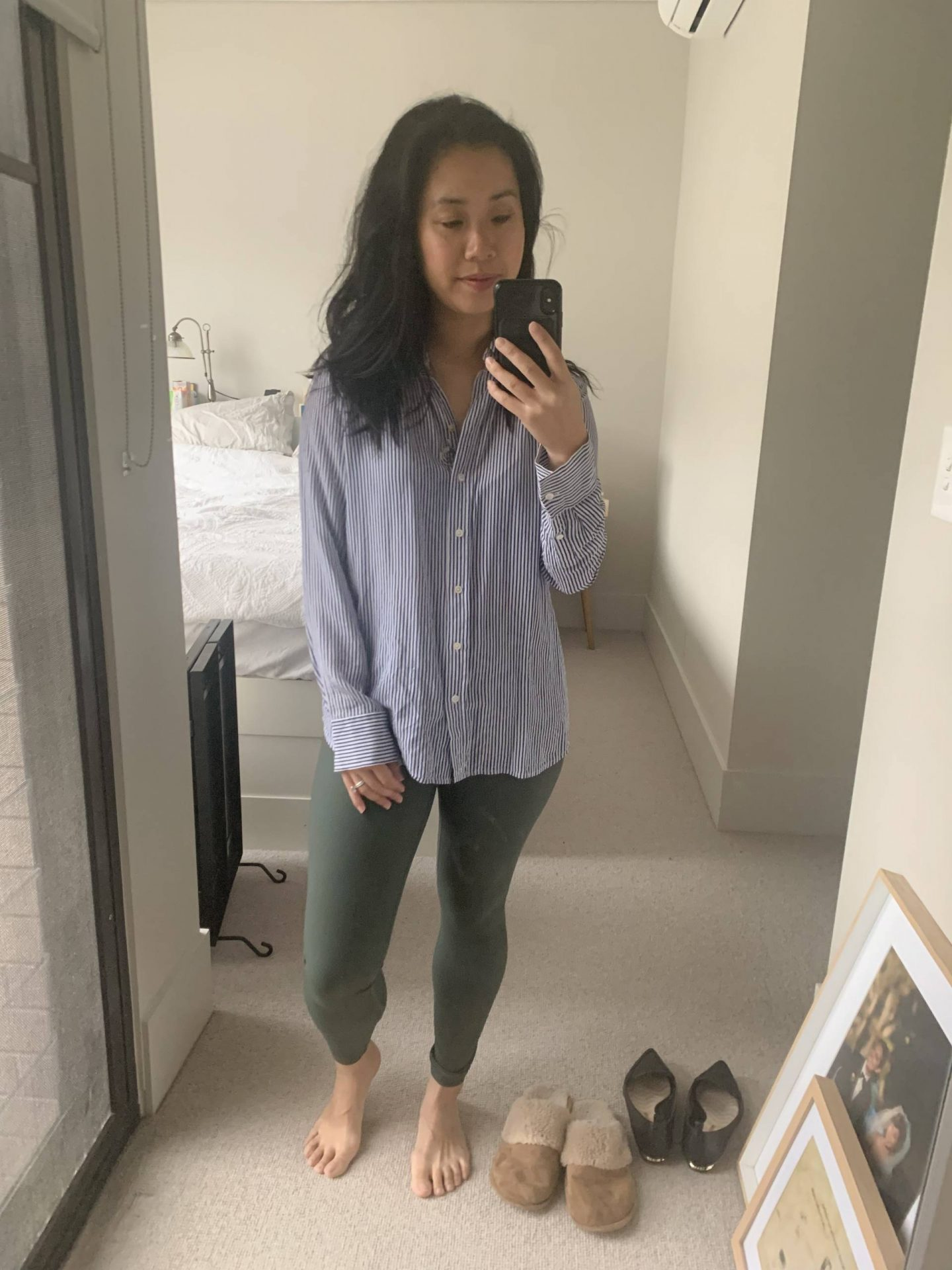 petite workwear blogger wearing silk shirt and leggings in blog post about comfortable wfh pieces