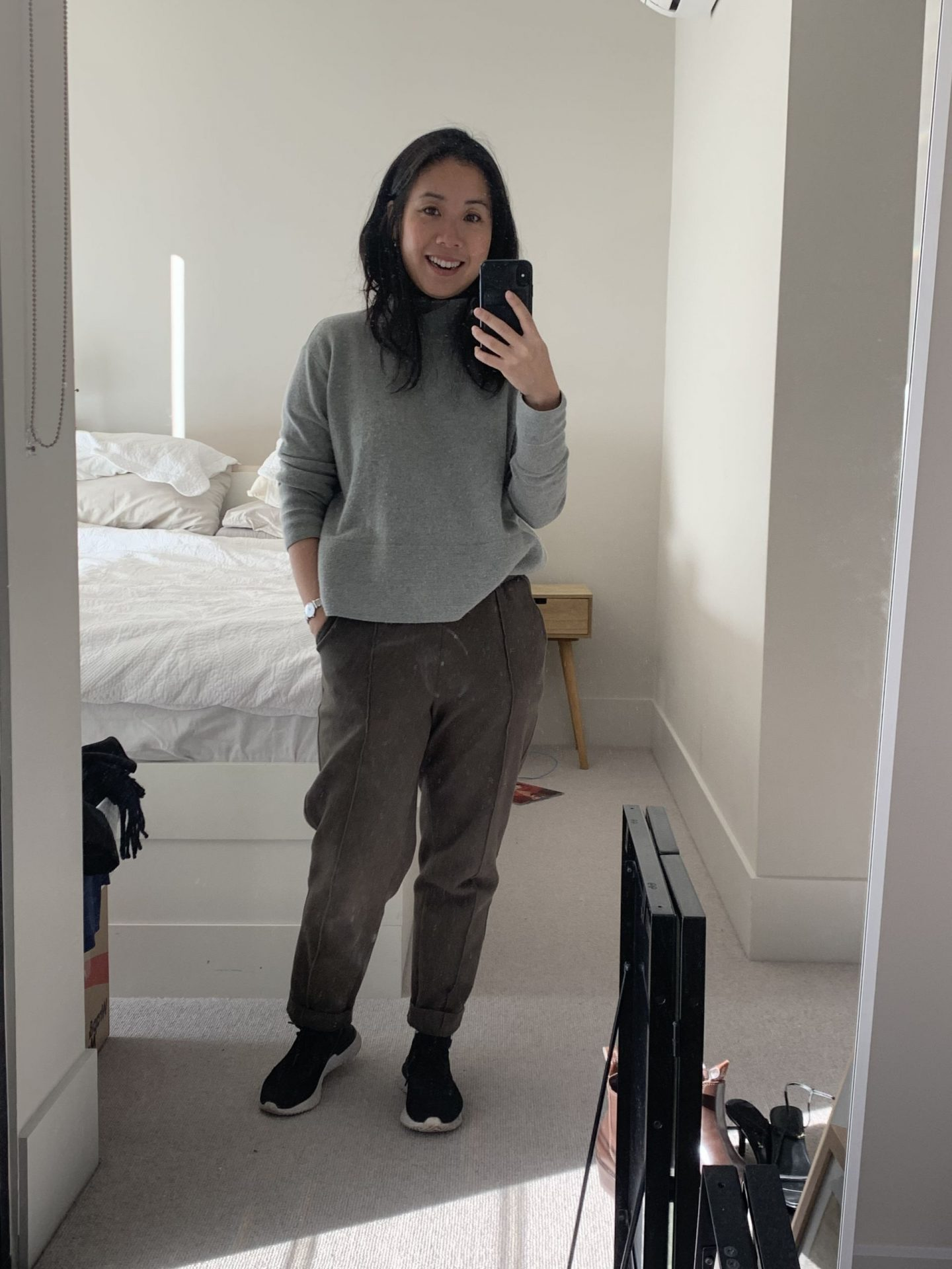 petite blogger wearing knit and track pants in blog post about comfortable wfh pieces