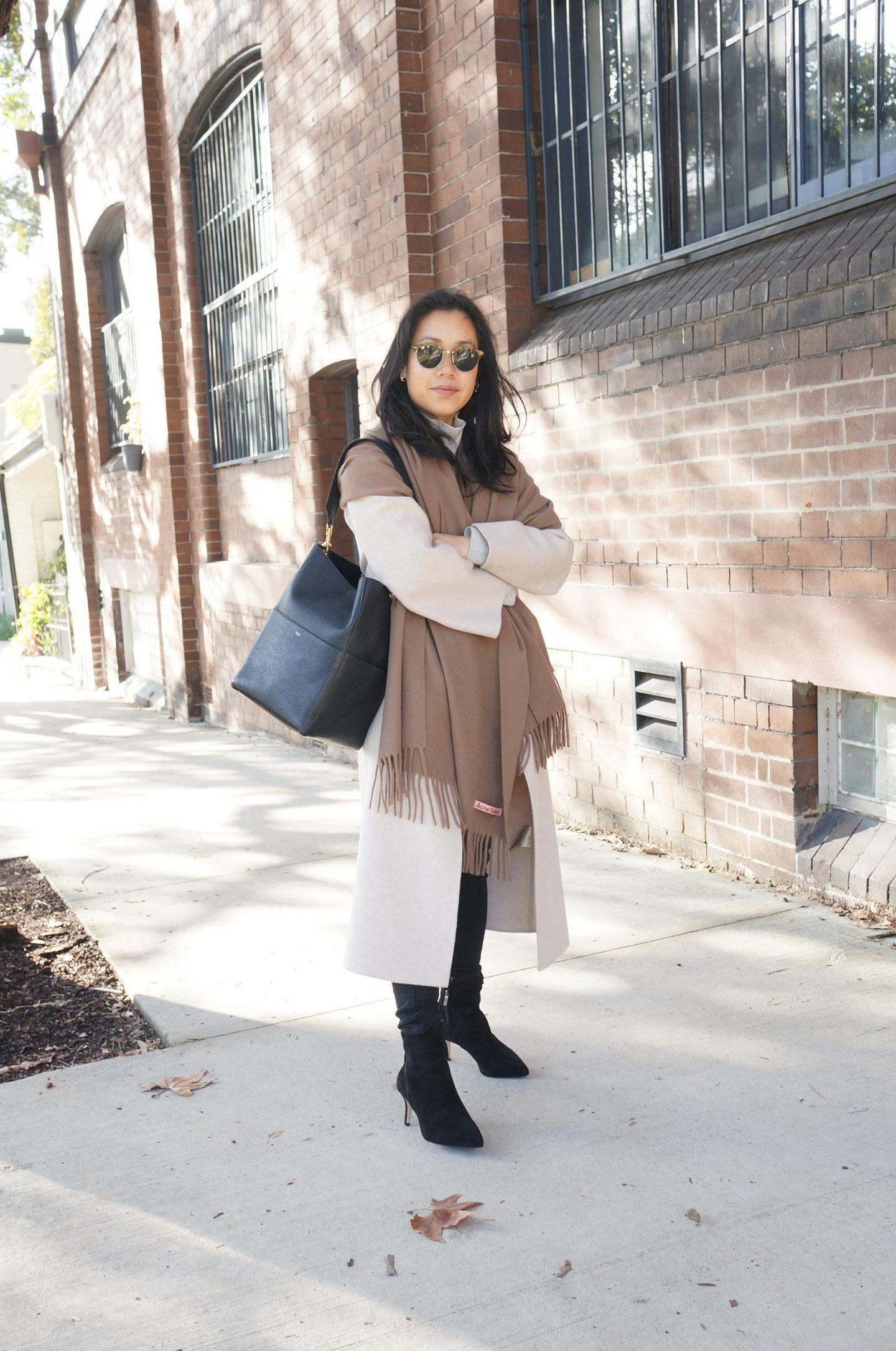photo of petite workwear blogger wearing sarah flint perfect dress bootie in blog post sharing review