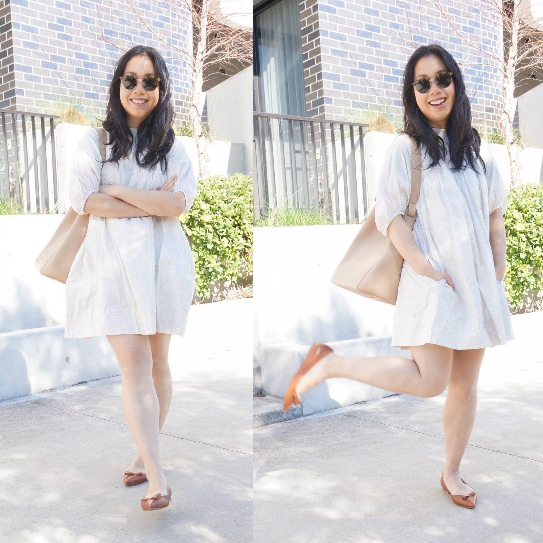 petite woman wearing everlane shirred mini dress in blog post sharing mini review