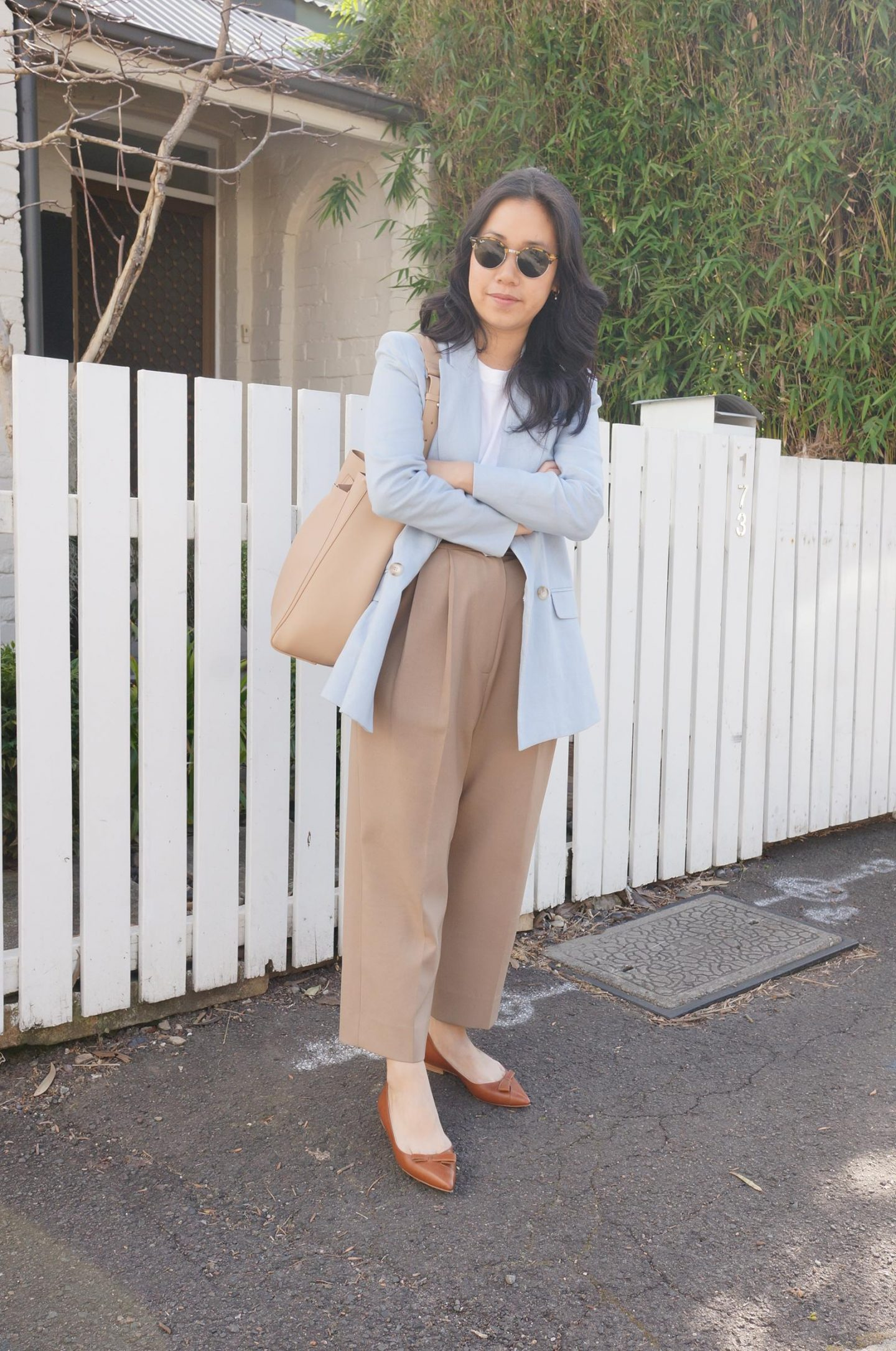 petite workwear blogger styling pointed toe flats in blog post about sarah flint natalie review